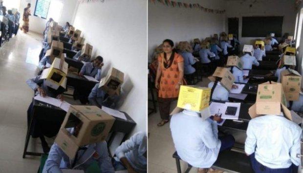 Щоб не списували: студентів в Індії змусили складати іспит з коробками на голові (ФОТО)